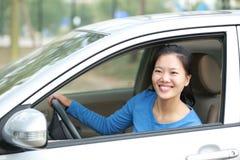 Woman driver driving a car Royalty Free Stock Photos