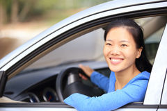 Woman driver driving a car Royalty Free Stock Photos
