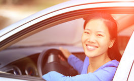 Woman driver driving a car Stock Images