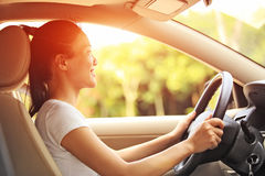 Woman driver driving a car. Happy woman driver driving a car Royalty Free Stock Image