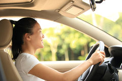 Woman driver driving a car Royalty Free Stock Image
