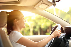 Woman driver driving a car. Happy woman driver driving a car Royalty Free Stock Images