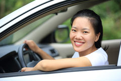 Woman driver driving car Stock Images