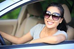 Woman driver driving car Stock Image