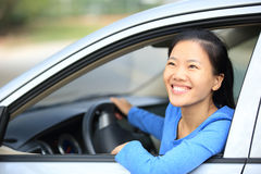 Woman driver driving a car Stock Photo