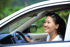 Woman driver driving in the nature Stock Photo