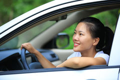 Woman driver driving in the nature Stock Photos