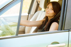 Woman driver hands holding steering wheel of a car Stock Photos