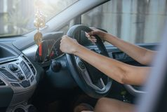 Woman driver hands holding steering wheel Royalty Free Stock Photography