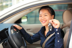 Woman driver happy with her first car Stock Photography