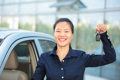 Woman driver happy with her first car Stock Image