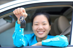 Woman driver happy with her first car Stock Images