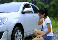 Woman driver have car problem. /on the phone for help Stock Photo