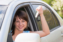 Woman driver after the helm of car with the keys. Young beautiful woman driver after the helm of car with the keys in hands Stock Photo