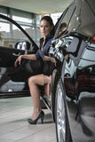 Woman driver with her new car Royalty Free Stock Image