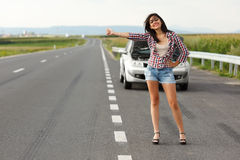 Woman driver hitch-hiking Stock Photo