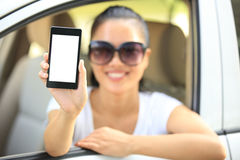 Woman driver hold blank cell phone in car Royalty Free Stock Image