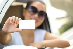 Woman driver hold one blank business card Royalty Free Stock Image