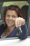 Woman driver holding car keys Royalty Free Stock Images