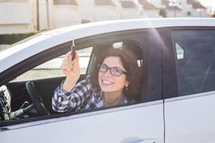 Woman Driver Holding Car Keys siting in Her New Car royalty free stock images