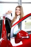 Woman Driver Holding Car Keys. Siting in Her New Car royalty free stock image