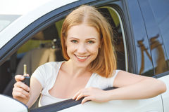 Woman driver with keys driving a new car Stock Photo