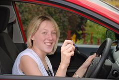 Woman driver with keys to car. Young woman driver holding key in car Royalty Free Stock Images