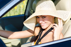 Woman driver in large sunhat Stock Image