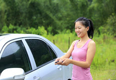 Woman driver lock/unlock car Stock Photo