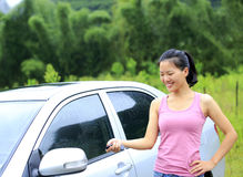 Woman driver lock/unlock car Royalty Free Stock Images