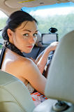 Woman driver looking back Stock Photos