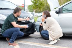 Woman driver and man arguing about the damage of the car Stock Photo