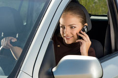 Woman driver with mobile phone. Royalty Free Stock Photos