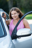 Woman driver near opened car door with key in hand Royalty Free Stock Photography