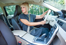Woman driver parking her car Royalty Free Stock Image