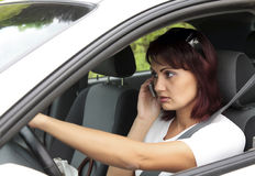 Woman driver on phone. While driving Stock Images