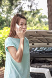 Woman driver on the phone for car breakdown Stock Photography