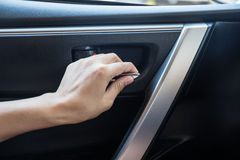 Woman driver pressing button locking and unlocking doors. In car Stock Images