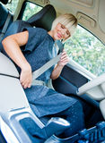 Woman driver putting safety belt Royalty Free Stock Photography