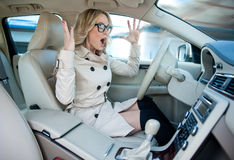 Woman driver in road rage. Attractive woman driver road rage and panic expression Royalty Free Stock Images