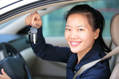 Woman driver show car keys. Asian woman driver happy with her new car Royalty Free Stock Image