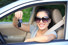 Woman driver show car keys. Asian woman driver happy with her new car Stock Photos