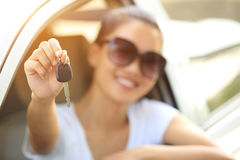 Woman driver show car keys. Asian woman driver happy with her new car Stock Images