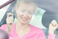 Woman driver showing car keys. Stock Photography