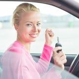 Woman driver showing car keys. Stock Photos
