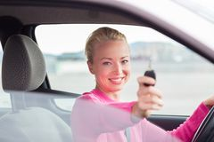 Woman driver showing car keys. Royalty Free Stock Photography