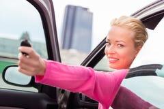 Woman driver showing car keys. Royalty Free Stock Photos