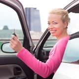 Woman driver showing car keys. Stock Images