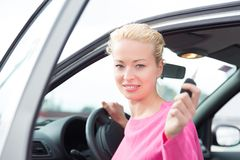 Woman driver showing car keys. Stock Photos