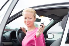 Woman driver showing car keys. Royalty Free Stock Photo